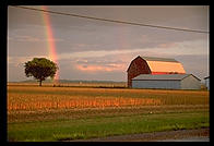 Rainbow and barn. Ontario, Canada.