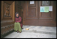 A gypsy begging on the steps of Florence's San Lorenzo