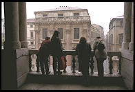 Kids look at at Vicenza's Piazza dei Signori, from the loggia designed by Palladio