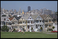 The Painted Ladies Victorian houses of Alamo Square, sometimes referred to as Postcard Row because of the backdrop of downtown skyscrapers.