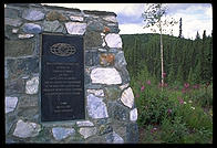 A stone monument erected by the Kiwanis International on the border between the US and Canada